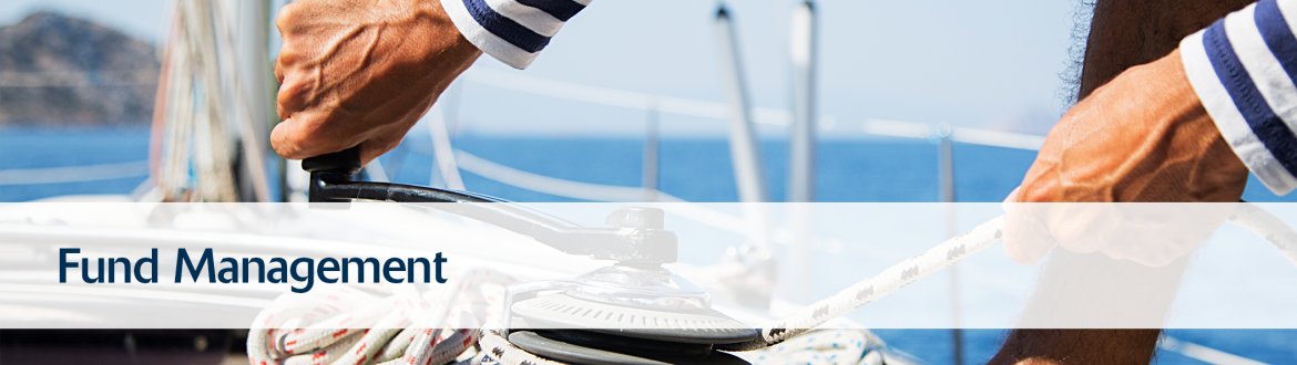 Man securing a rope on sailboat representing Fund Management Services within Southern Charter Financial Services